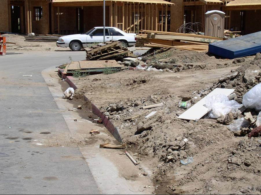 Dirt and other construction materials spilling onto street